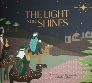 The Light Still Shines. A Christmas rub-down transfer and coloring book